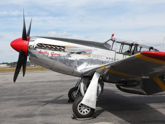 A P-51 fighter plane is shown on the Million Air tarmac