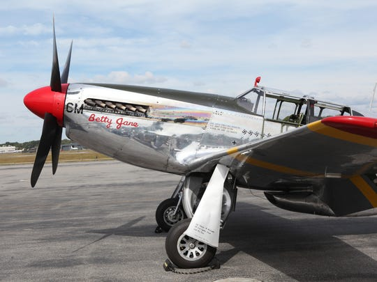 A P-51 fighter plane is shown on the Million Air tarmac at the Westchester County Airport. The legendary plane is part of the Wings of Freedom Tour.