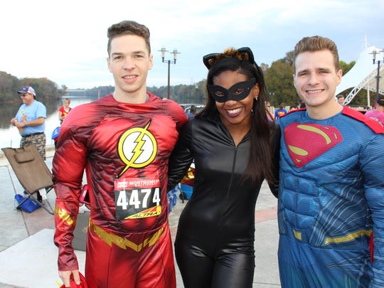 """Super Heroes"" from left: Ben Lang, Jalea Brooks and Darrell Puckett took part Saturday in the inaugural Montgomery CW Super Hero 4K and one mile fun run. Alvin Benn/Special to the Advertiser"