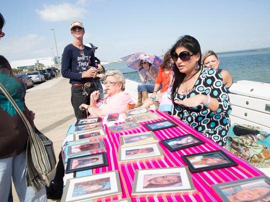 Kitana Sanchez discusses with rally attendees the number of homicides committed against transgender people that have occurred across the nation in 2017 at a rally in front of the Federal Courthouse in Corpus Christi on Saturday, Nov. 4, 2017.