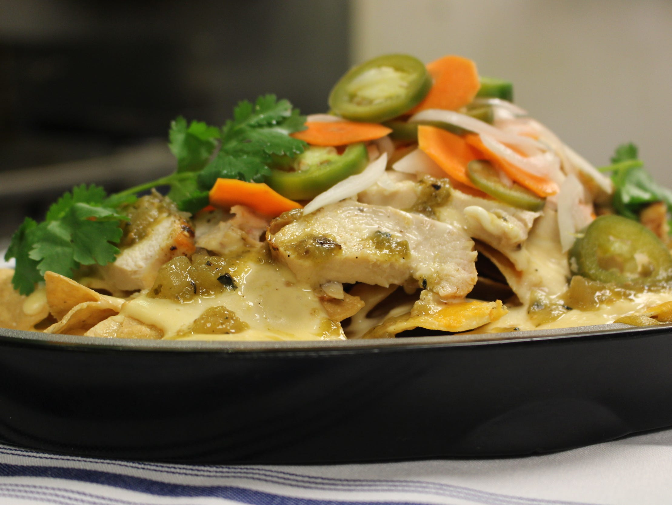 Test out this delicious nacho recipe at your next tailgate.