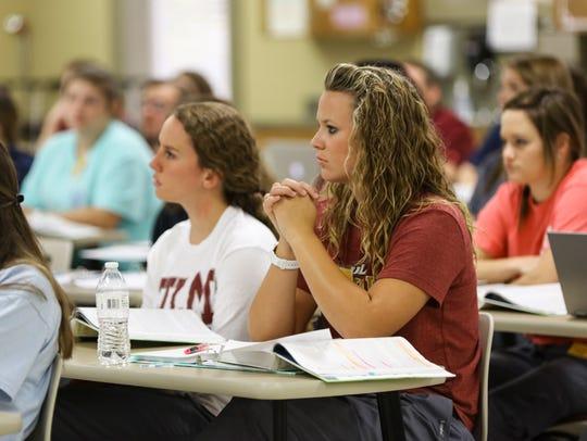 Nursing students attend a physical assessment class