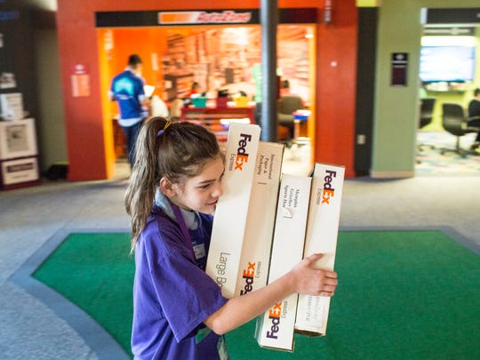 December 15, 2017 - Hazel Jones, 11, a 6th grader from Our Lady of Sorrow Elementary School, makes a FedEx delivery inside of Junior Achievement's JA BizTown. JA BizTown is a simulated city where students learn business skills and put in action the lessons that they've learned in classes the previous five weeks.