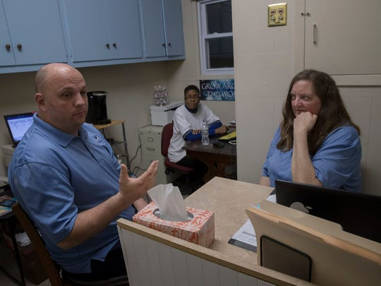 Paul Hulse, Martha Barnhill and Patty Oyola of HAVEN/Beat the Street discuss Code Blue at the Ocean County warming center in Toms River, based in the First Assembly Church of God.