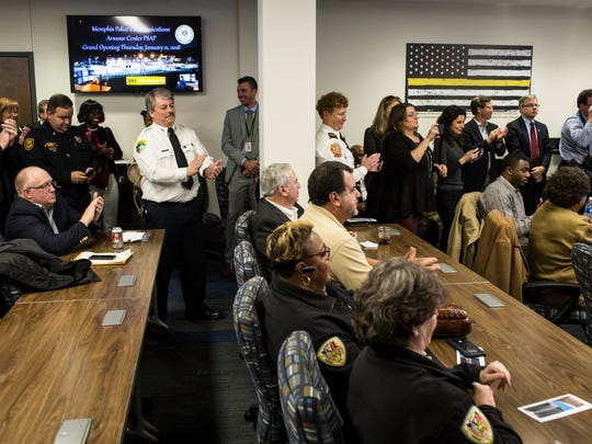 January 11, 2018 - Memphis police, fire and other attendees applaud during the debut of the new Memphis Police 911 Call Center, a state-of-the-art facility just above the existing fire dispatch offices at 79 Flicker Street.Ê