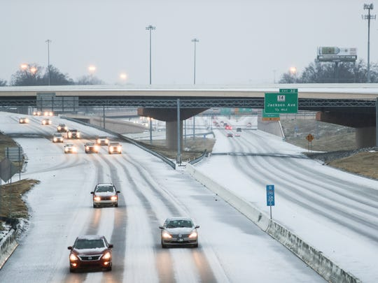 January 12, 2018 - People make their way along I-240 for their morning drive on the ice and snow covered highway.