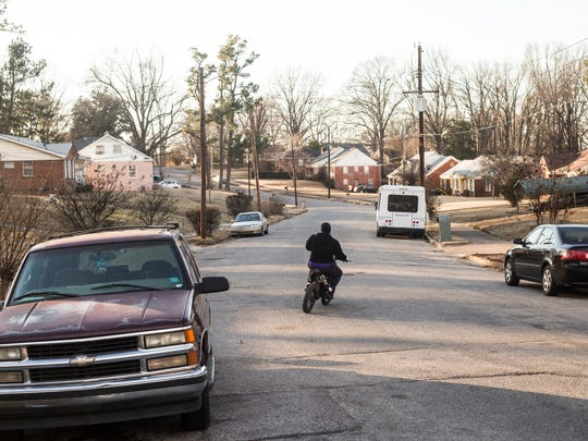 "A young man rides a dirt bike on Wellons Avenue in Frayser on Jan. 30, 2018. Frayser was hit hardest by what local economist David Ciscel calls ""the complete transformation of the Memphis economy"" from one that's manufacturing based to one that's heavily reliant on services, logistics and health care."