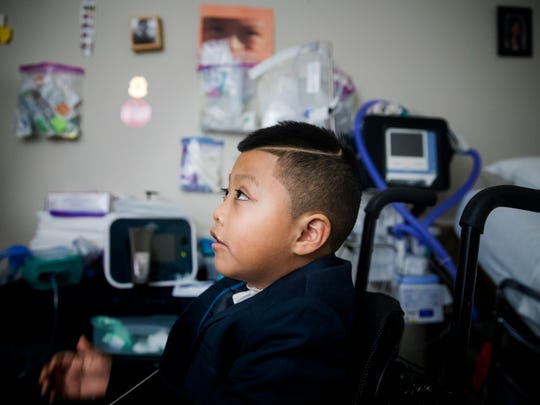 Ricky Solis, 6, waits in his wheelchair to drive to his mother's wedding at Morrow County Jail in Mount Gilead, Ohio. His mom's fiancé, Yancarlos Mendez, has been detained by ICE for more than two months.