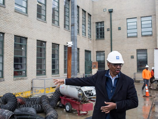 Jimmie Tucker guides a tour of the renovation to the