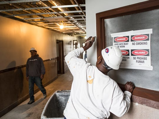 Workers are busy inside the Universal Life Insurance building March 16, 2018. Owners and architects Juan Self and Jimmie Tucker are closing in on completion of a $6.2 million renovation intended to create a showcase of history and sustainability and a collection of resources dedicated to growing disadvantaged businesses. Self+Tucker Architects and the City of Memphis Business Development Center are expected to move into 480 Dr. Martin Luther King Blvd. this spring.