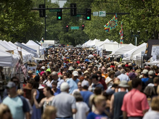 Visitors take in the atmosphere of the 34th Main Street Festival in Franklin.