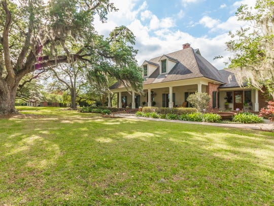 This home sits on more than 5 acres of beautiful tree lined property.
