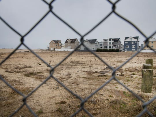 """A set of seven single-family homes called """"Osborn Estates"""" is proposed on an area of the former Camp Osborn, which burned down during superstorm Sandy."""