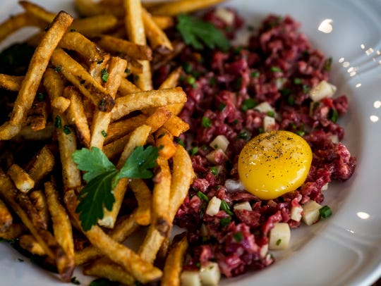 "Sacred Beast's steak ""tartare"" frites with pickled"