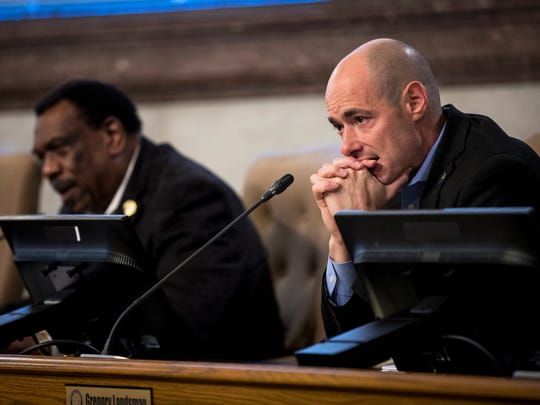 Councilman Greg Landsman listen to testimony at the