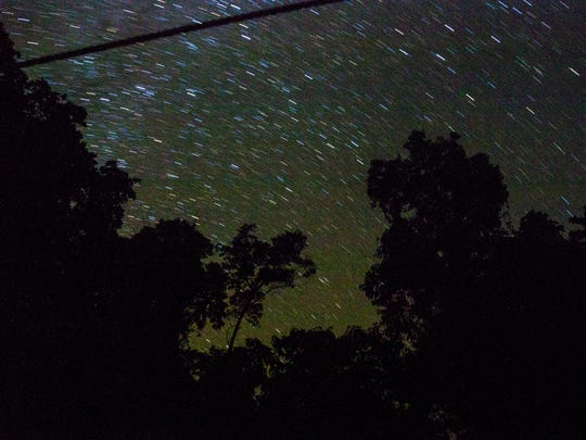 Stars travel above the Goualougo Triangle basecamp.