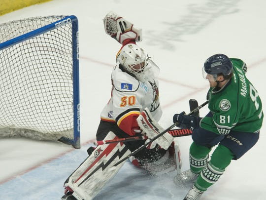 Everblades forward Stephen MacAulay shoots the puck past Thunder goaltender Drew Fielding during Game 4 of the Eastern Conference Finals at Cool Insuring Arena in Glens Falls, N.Y., on Friday, May 18, 2018.