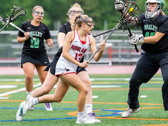 Northern Highlands midfielder #13 Lindsey Coleman taking a shot during the North 1, Group 3 Girls Lacrosse state sectional semi-finals at Northern Highlands High School. Tuesday, May 22, 2018.