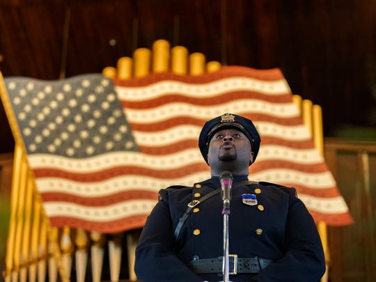 Asbury Park Office Tyron McAllistair aings The National Anthem at the start of service. New Jersey Law Enforcement Memorial Service at the Great Auditorium  in Ocean Grove on May 22, 2018
