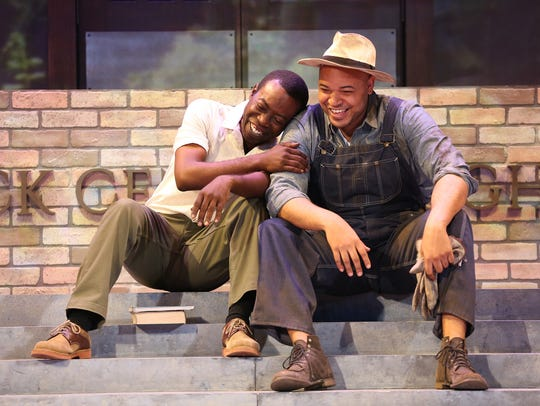 Charlie Hudson III, left, portrays Ernest Green, a