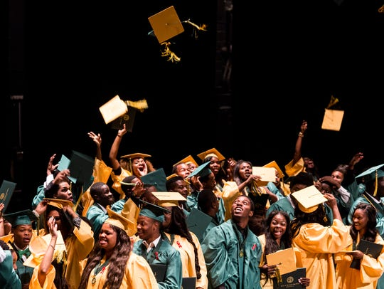 Booker T. Washington High School seniors toss their graduation caps into the air at the conclusion of their graduation ceremony at the Orpheum Theatre in May 2016. Booker T. Washington High sent 35 students to an in-state public college, and 97 percent of them were required to take remedial math. Nearly 80 percent needed the remedial English course.