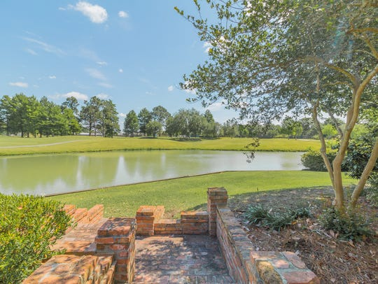 There are views of the golf course and pond from the