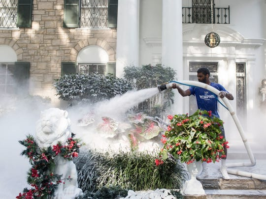 "Justin Kelley works to transform the grounds around the mansion at Graceland into a winter wonderland for the filming of the Hallmark Channel's new movie, ""Christmas at Graceland"" July 19, 2018."