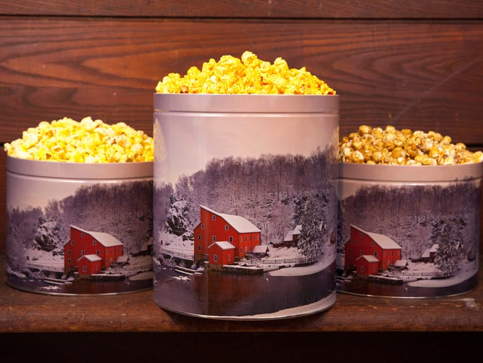 Popcorn Nation popcorn in a Red Mill themed tin.