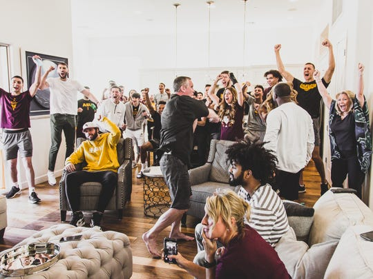 Members of the ASU basketball team celebrate the announcement
