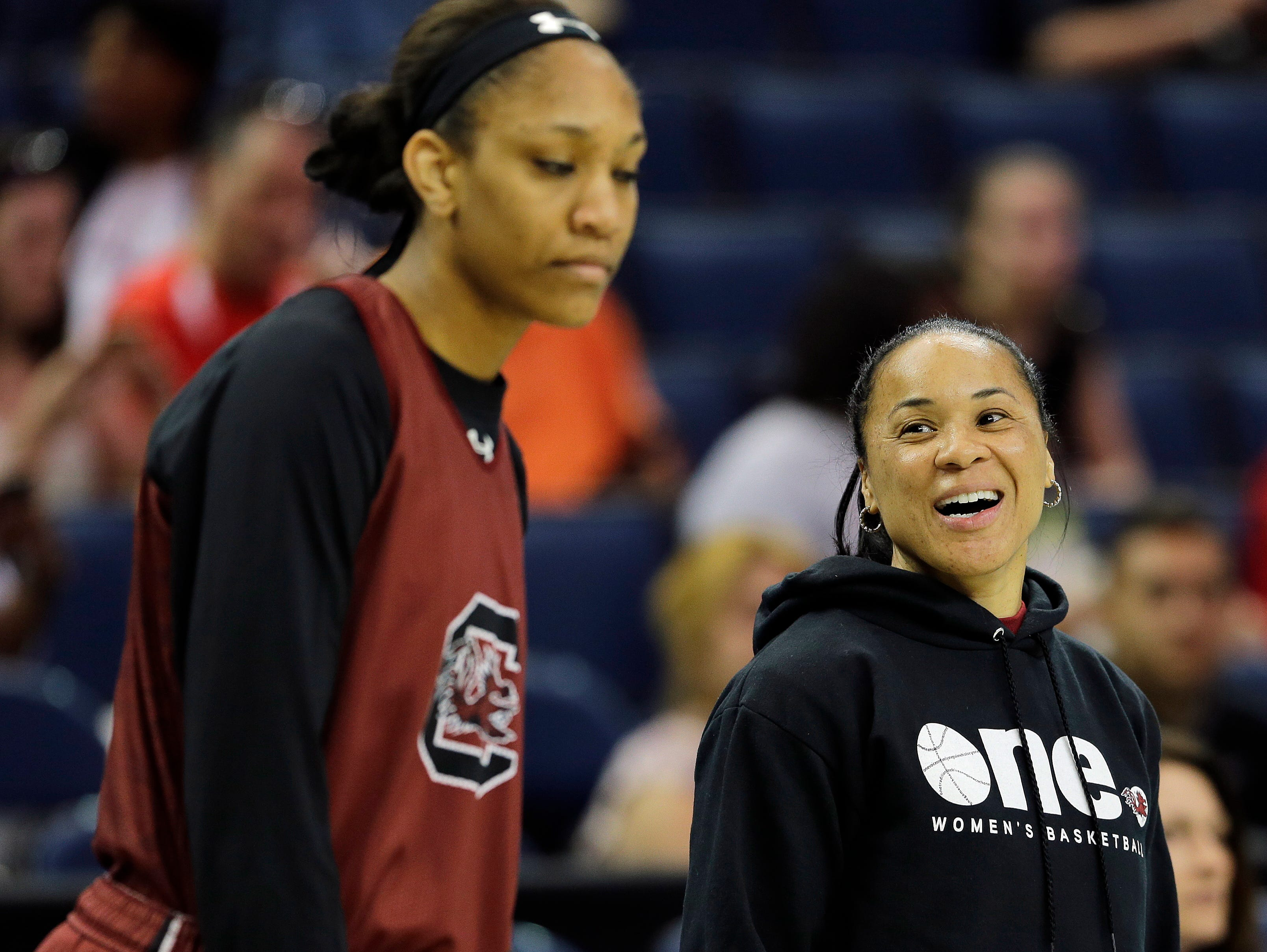 South Carolina head coach Dawn Staley speaks to South Carolina player A'ja Wilson during a practice session for the NCAA Final Four tournament women's college basketball semifinal game, Saturday, April 4, 2015, in Tampa, Fla. South Carolina plays Notre Dame Saturday in a semifinal game. (AP Photo/Chris O'Meara)