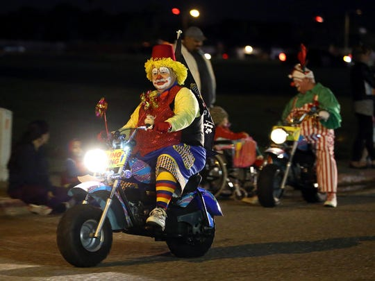 Members of the Al Amin Shrine Clowns drive around greeting children during the Christmas in Portland Parade of Lights on Monday, Dec. 5, 2016, in Portland.