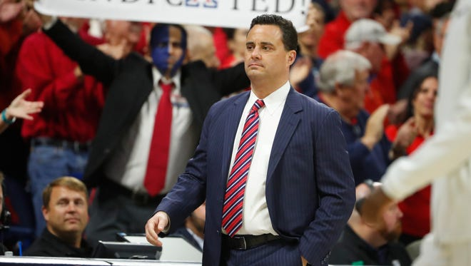 Arizona's head coach Sean Miller walks onto the court before a game against Stanford at McKale Center on March 1, 2018 in Tucson, Ariz.