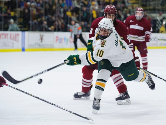 Vermont forward Travis Blanleil (10) shoots the puck