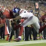 Buccaneers quarterback Jameis Winston scores past Giants strong safety Brandon Meriweather on Sunday in Tampa.