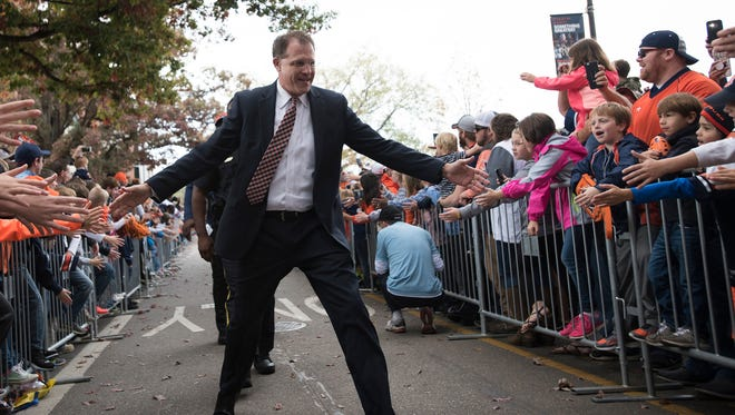 Auburn head coach Gus Malzahn greets fans during Tiger Walk before the NCAA football game between Auburn and Louisiana Monroe on Saturday, Nov. 18, 2017, in Auburn, Ala.