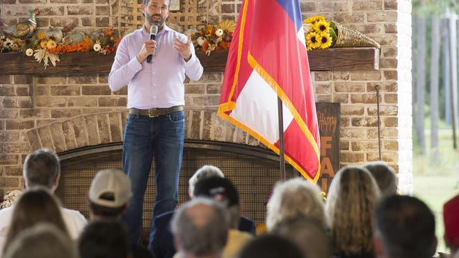 Donald Trump Jr. talks to supporters at a rally at Forest City Gun Club on Monday.