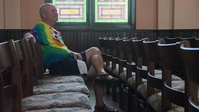 Lance Wilhelm sits in his regular spot on Monday at Asbury Memorial Church.