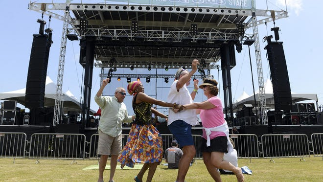 Savannah Music Festival attendees dance to the music of Betsayda Machado Y Parranda El Clavo at the Savannah Music Festival Finale on Saturday at Trustees Garden.