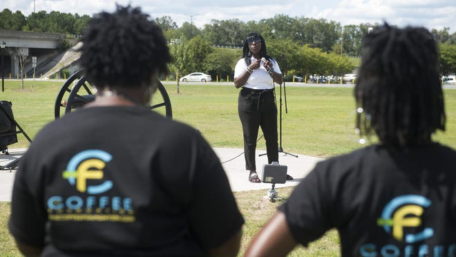 Zelonia Williams, the founder and executive director of Future Minds Literacy and Adult Education Inc., speaks to the crowd at the Pooler Rally for Diversity and Inclusion in Pooler Memorial Park on Sunday. The event aimed to bring together Pooler's Black community to showcase business leaders in the city and the services they offer.