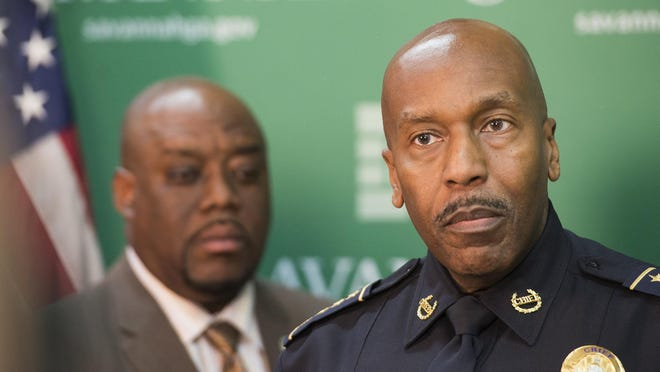 Mayor Van Johnson and Police Chief Roy Minter at a recent press conference.