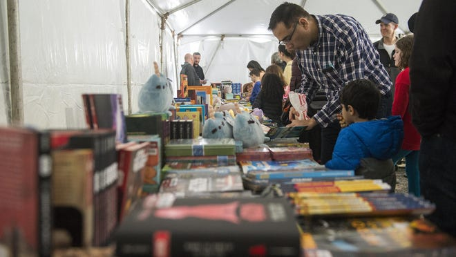 People browse the books available for purchase at the Savannah Book Festival's Children's Tent in this file photo. The event drew hundreds of children and their parents to St. Julian Street.