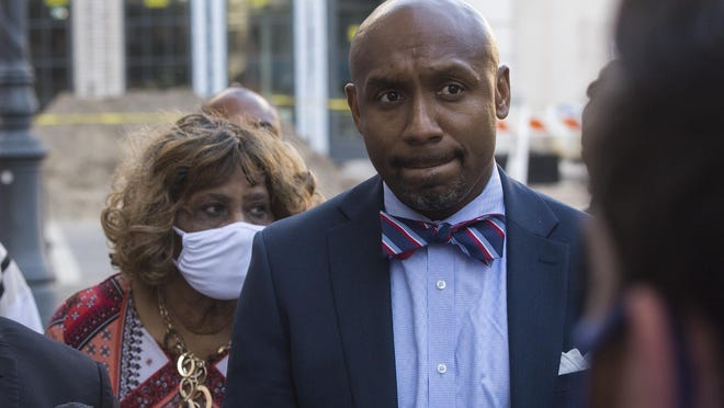 Attorney Mawuli Davis, right, stands with Lindsay Milton, the mother of Julian Davis, a man killed by Georgia State Patrol trooper Jacob Thompson on Aug. 7. The family intends to sue the state of Georgia for $12 million.