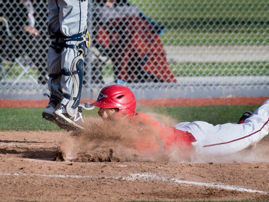 Tulare Western's David Alcantar scores on an in-park