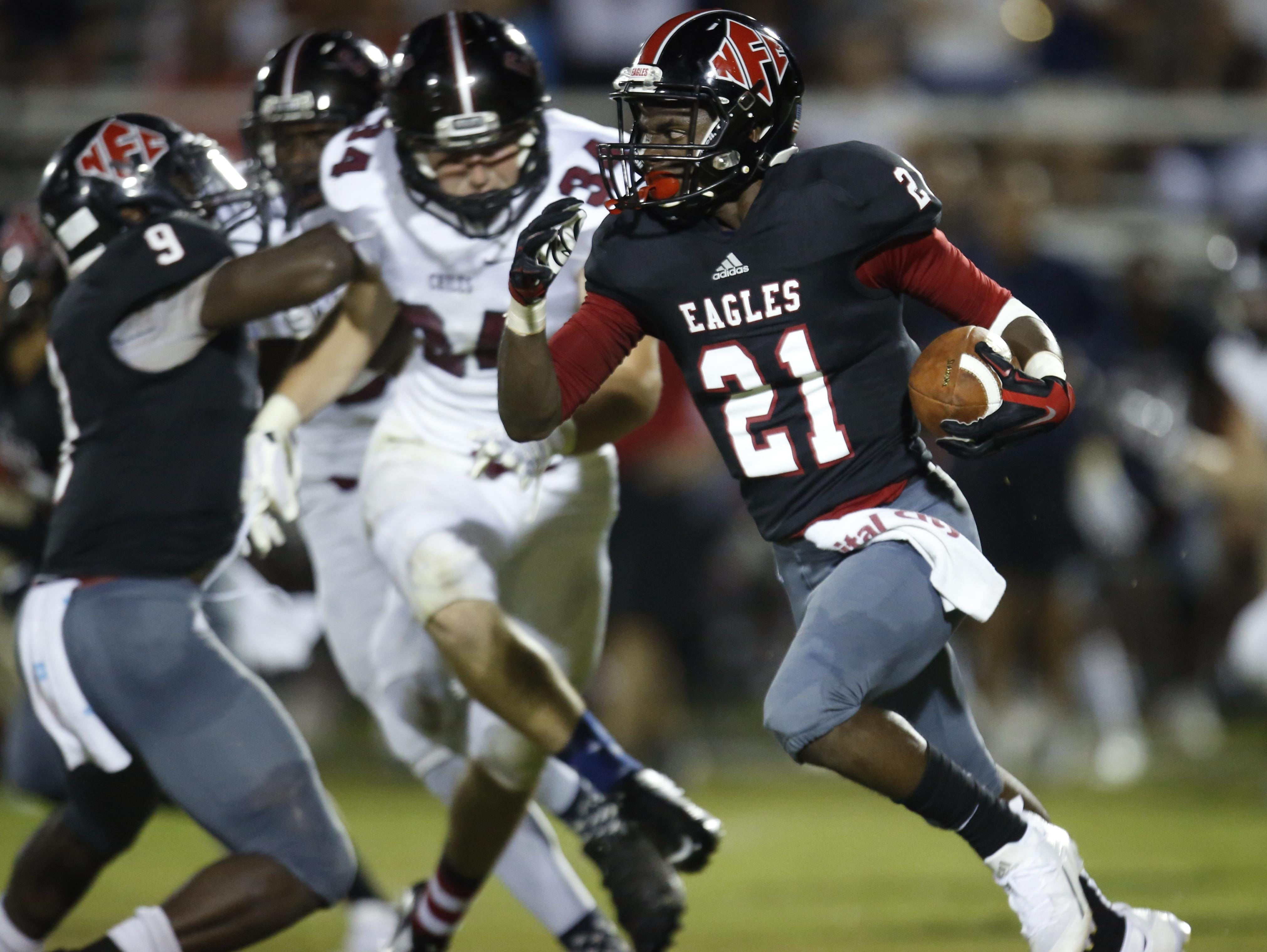 NFC's T.J. Ashley returns a kickoff against Chiles during their game at North Florida Christian on Friday.