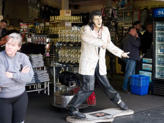 A statue of Elvis Presley is stationed for folks to