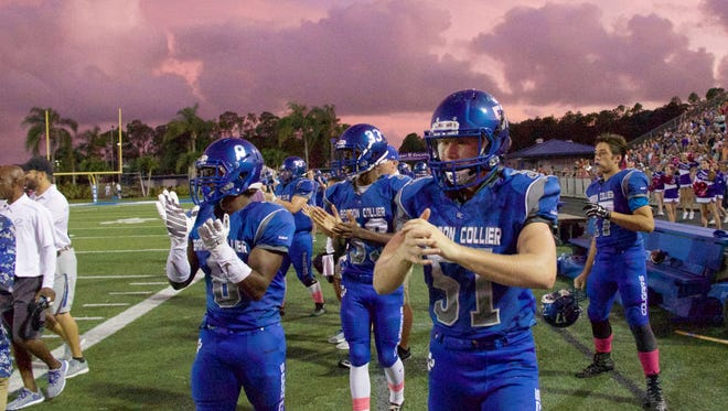 Barron Collier celebrating after Kevin Thorne (10) intercepts the ball in the 1st quarter.