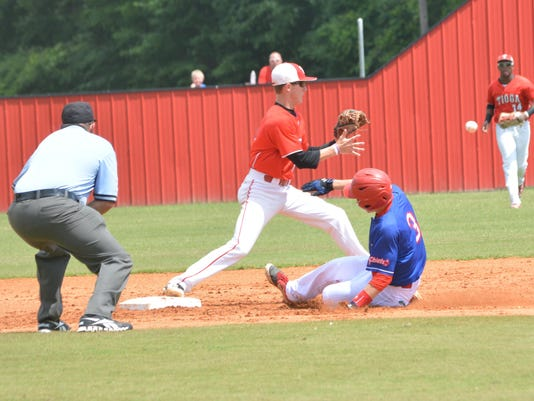 ANI Tioga vs. West Ouachita Tioga's Brady McGehee (8, center) makes the tag at second for an out against West Ouachita's Drew Thomas (3, right) Saturday, May 9, 2015.-Melinda Martinez/The Town Talk