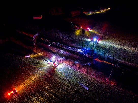 This photo provided by Nicholas Waun shows the scene where two trains collided and derailed in Georgetown, Ky., early Monday, March 19, 2018. Four people were taken to the hospital after the accident late Sunday night