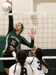 Cloudcroft's Laci Toddy hammers a ball onto the court Thursday evening.