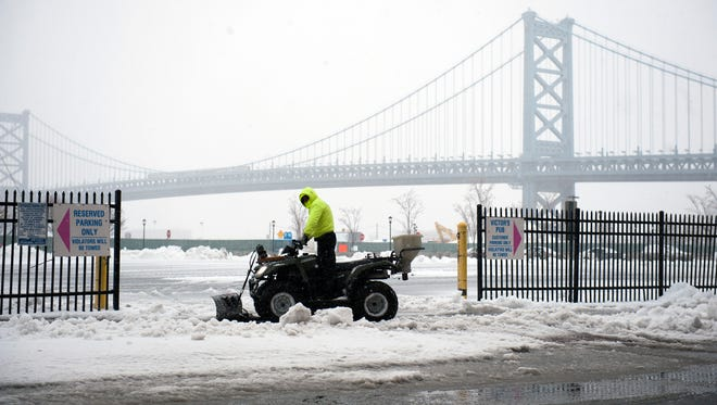 A snow removal crew member readies his ATV to plow a Camden parking lot after a 2017 snowfall.